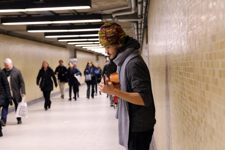 Daniel Rivera playing the Ukulele on a Saturday morning at Square Victoria Station. Photo credit: Samantha Stevens